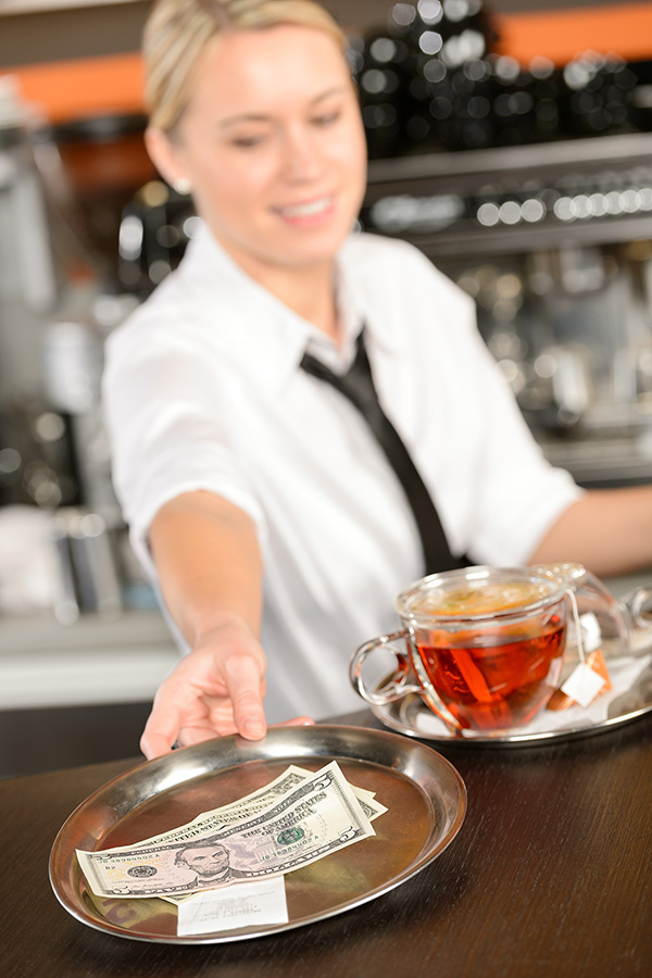 tipping bartender at restaurant