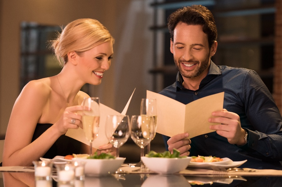 Couple reviewing restaurant seasonal menu - update and keep track remotely with a cloud menu management system