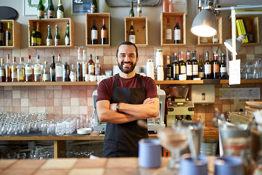 restaurant manager standing at restaurant point of sale