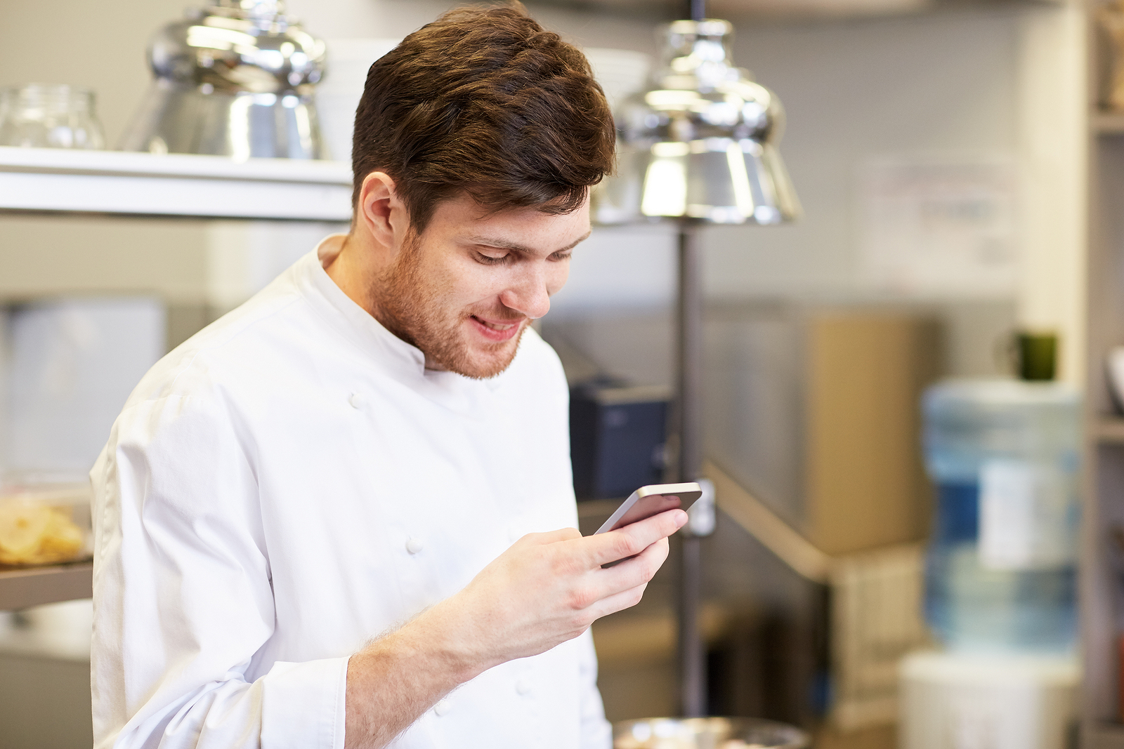 chef looking at restaurant repair and maintenance app