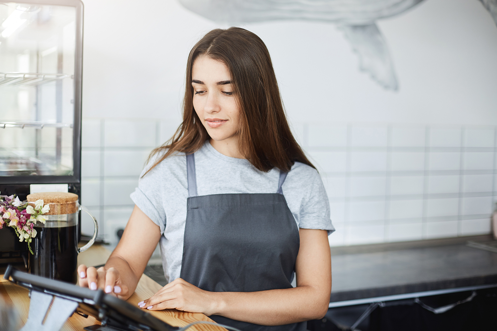woman checking restaurant pos software