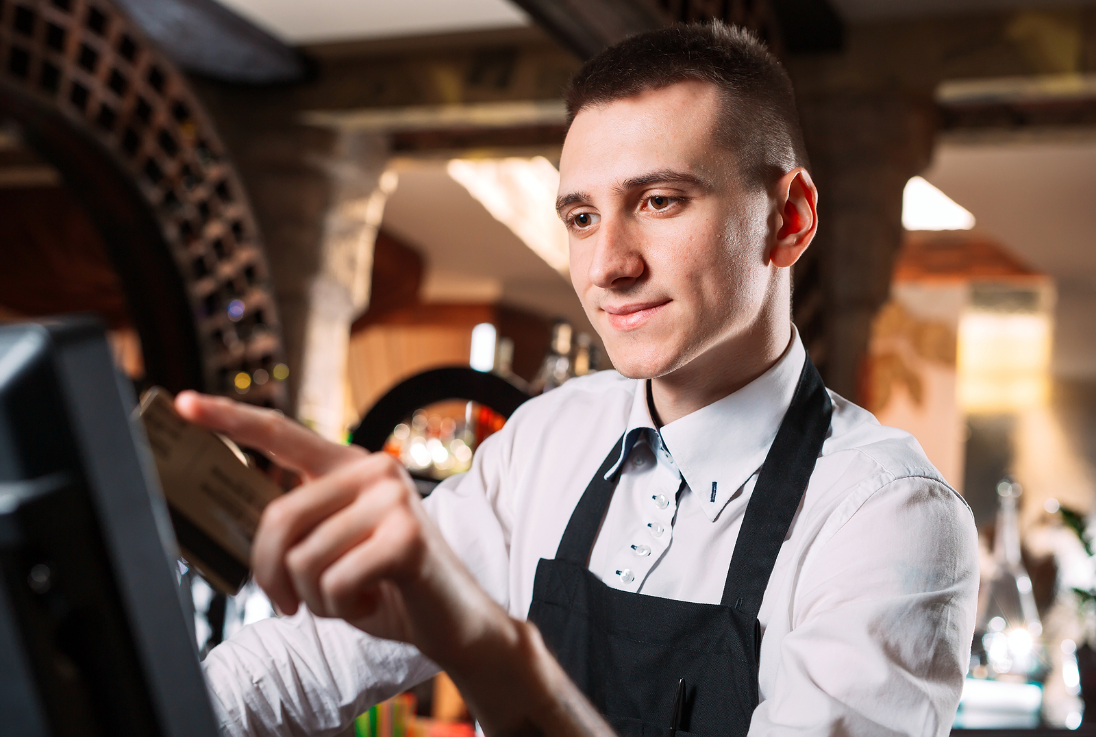 waiter using restuarant point of sale system
